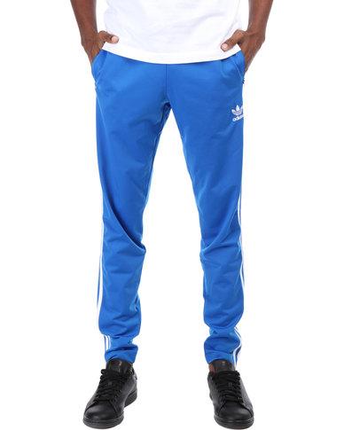 f2273db6182e adidas Open Hem Track Pants Blue