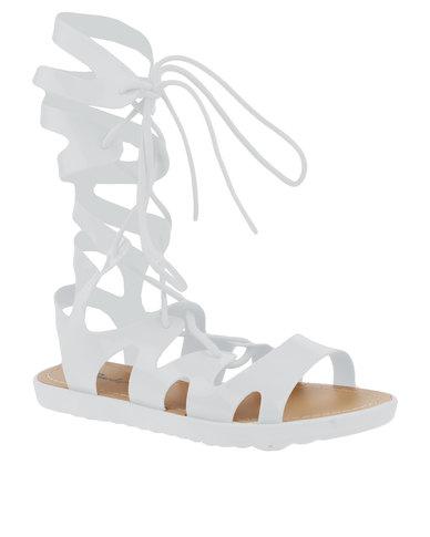 bcb69ce67845 Candy Flat Gladiator Lace Up Sandal White