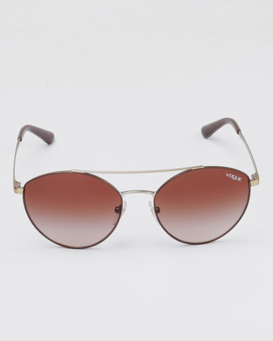 b9396ae7e Complete the look. Vogue Matte Pink/Rose Gold Frame Mirror Lens Sunglasses  ...