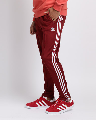 pretty nice 6e57f de487 adidas Mens Beckenbauer Track Pants Rust Red White   Zando