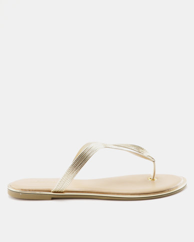 5154a2500634 Bata Ladies Flat Thong Sandal Gold
