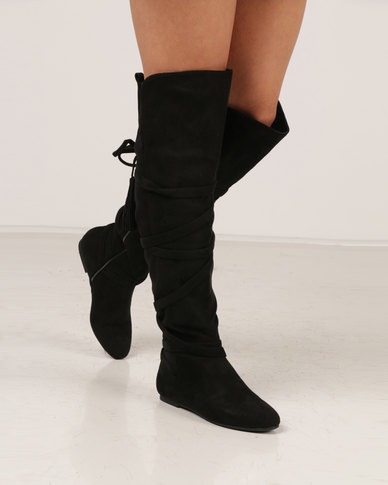 61852d61050 Madison Berklee Long Tassel Trim Flat Boots Black | Zando