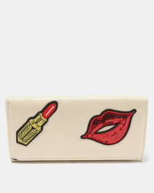 Utopia Lipstick Purse Cream