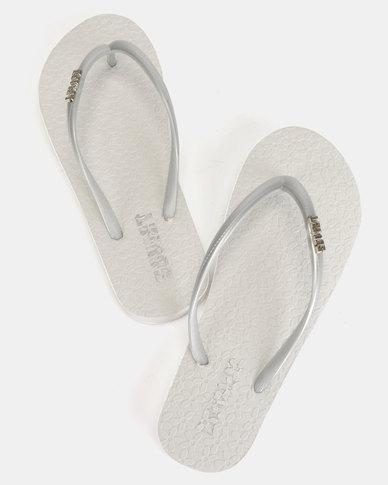 25729c95ecb2cc Soviet Rina Ladies Rubber Thong Sandals White Silver