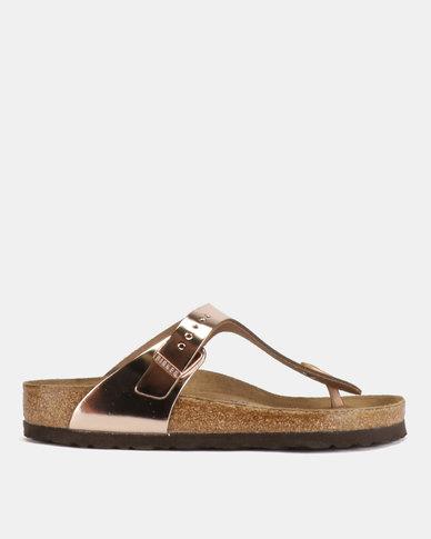2de5860af2d4 Complete the look. Birkenstock Gizeh Leather Sandals Metallic Copper ...
