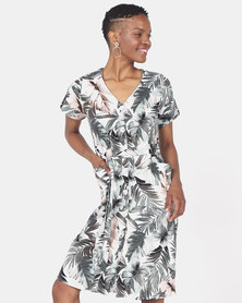 UTOPIA CREAM BASED LEAF PRINT FLARE DRESS WITH POCKETS