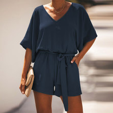 V'NECK SHORT BATWING SLEEVE PLAYSUIT WITH BACK BUTTON FASTENING, SIDE INSET POCKETS, ELASTICATED WAIST & TIE BELT DETAIL