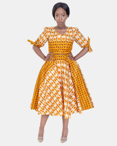 ONA Orange Half Rap Dress with a Matching Head Rap
