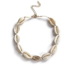 By Cara White and Gold Cowrie Choker